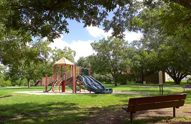 Playground and seating at Pecan Park